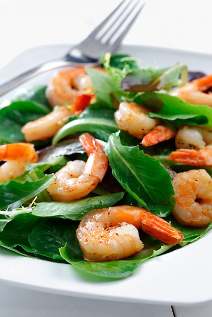Flambéed Shrimp on Mixed Greens with Lemon Vinaigrette