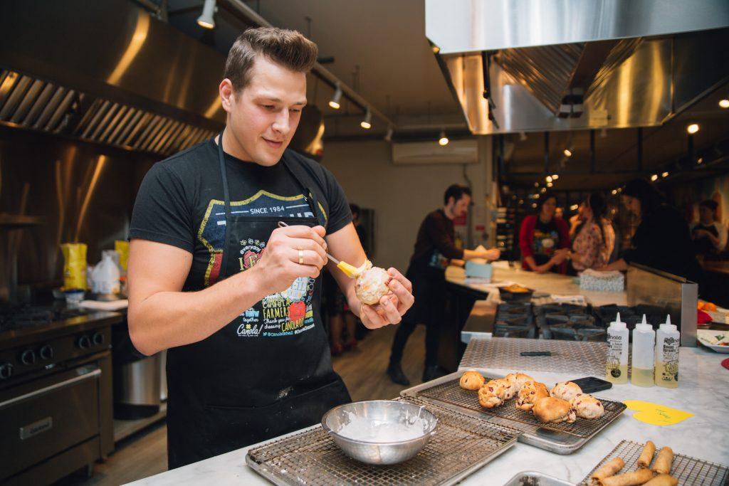 Paul Lillakas baking at a Canola Eat Well event